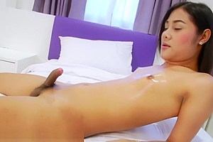 Petite tgirl strokes cock