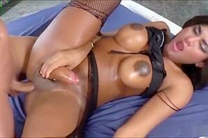 Tanned tgirl vixen Jennifer Rios strokes her rock hard cock
