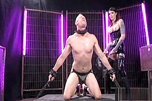 Tranny In Black Latex Whips Her Sub