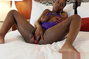 Ebony shemale jerks off until a warm ending