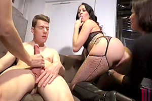 Two tgirl MILFs play with a young couple