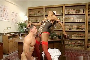 Ts Nurse Natassia Bends her Boss over his Desk and Fucks his Ass