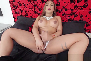 Glamorous shemale with big round melons jerking off