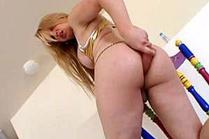 Blonde Tcutie plays with toy