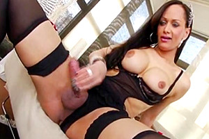 Lingerie clad shemale shows off